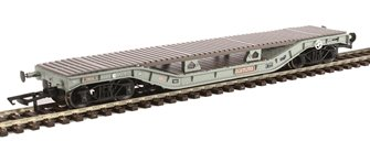 Warwell wagon 50t with diamond frame bogies DM748343 in BR grey with bolster deck conversion